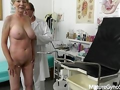 Fake doctor secretly records gyno exam of supreme looking granny with good-sized tits