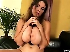 Playing with her massive tits