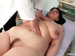 Gyno specialist examines saggy tittied brunette