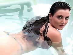 Big funbag brunette plays in water