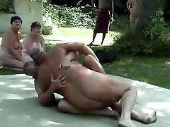 Outdoor male grappling naked