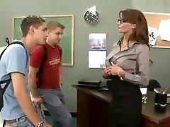 Buxomy brunette teacher fucks and sucks her two students in three way