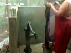 thick beautiful woman indian bhabhi taking douche from pump