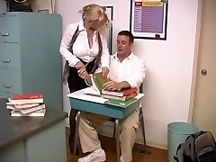 Mature blondie with enormous breasts screwed by schoolgirl in the classroom