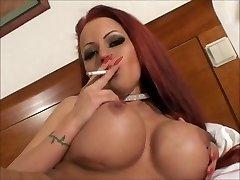 Mind-blowing big tit smoking redhead masturbating