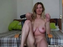 MILF with large boobs fumbles her mature pussy