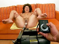 Massive cougar chick is testing a new sex machine with her gams spread wide open