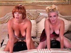 2 gals riding two fuck machine on a bed