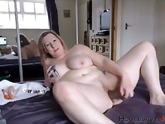 Plumper mature Carmen with huge tattooed tits rides a fuck stick