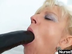 Old blonde cougar stuffing pussy with thick dildo