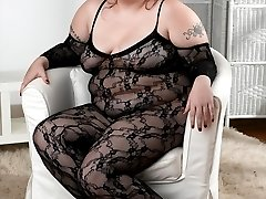 Cierra is wearing her fishnet lingerie and nothing else! The red head fatty feels very sexy and...