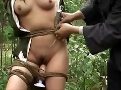 Asian army dame tied to tree 3
