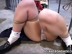 She is tied up to the jail cell and toy fucked