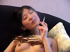 Japanese Smoking Naked on Bed