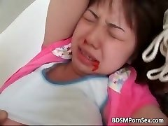 Cute young asian honey is strapped part1