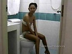 Thai Escort Sucks Trouser Snake in the Toilet