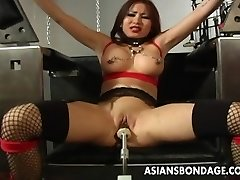Busty dark haired getting her wet cunny machine fucked