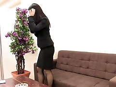 Chick in suit and tights masturbates when she is alone