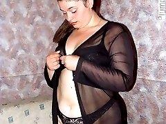 Kinky mature plumper stripping in black lingerie