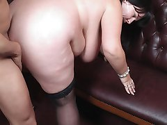 Horny customer gets it on with a gorgeous heavy-racked barmaid right on the counter