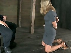 Sassy bitch Simone Sonay gets her forearms corded up and has to suck a cock