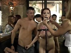 Redhead slave getting facials in public