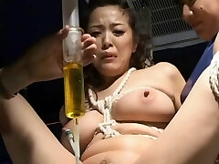 BDSM: Asian w catheter stroked and re-filled