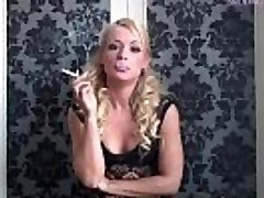 Jools Brooke - Smokes in Dark-hued Lace Clothing