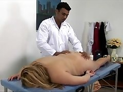 Big blonde gal gets fucked on the rubdown table