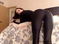 Stunning dark-hued latex catsuit girl
