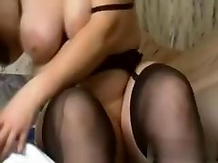 I am this naughty slut with large amateur tits, who is dressed in high heels, while ravaging a massive black dildo.