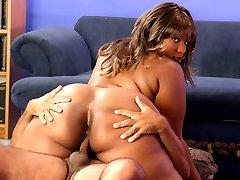 Big black BBW squeezes dick between her big fat tits!