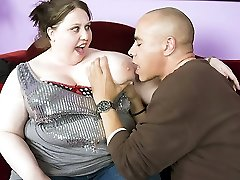 BBW Jelli Bean flaunts her huge knockers and lets a horny guy admire it by nibbling at her...
