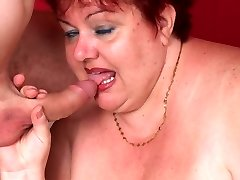 Wild mature Margaret stretched legged on the couch while a cock pounds her fat snatch