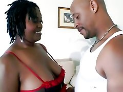 Chubby black chick Tigger drills her cooter with a sex toy while giving a blowjob in this porn...