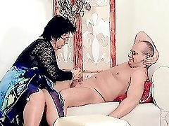 Big titted granny stuffing her plump pussy with cock