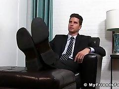 Trendy jock in suit enjoying is some sloppy feet fellating