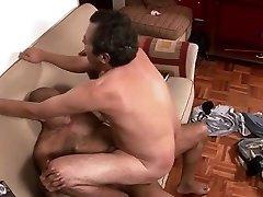 Elder Gay Couple Making Sweet Gay Love On The Sofa