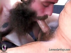 Two bearded gay dudes are blowing hard