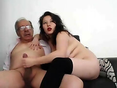 A young woman masturbate an old man and he completed