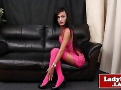 Lingeried ladyboy spreads ass and tugs solo