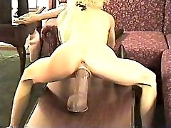 Humping a good-sized dildo