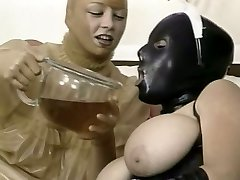 Two kinky girls in latex outfit lick each other snatches in 69 fashion