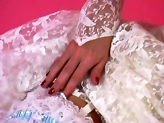 An Erotic Tease 001-A Dark-haired Hair Bride Unclothes Out of Her Suit