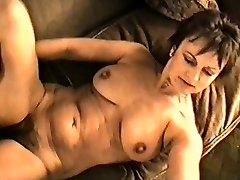 Yvonne's huge bosoms hard nipples and hairy pussy