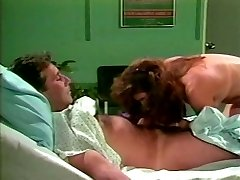 Dark haired lut jumps on meatpipe of one patient in a medical center