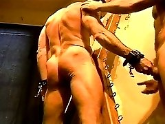 Huge bodybuilder's muscle butt gets an ass whuppin' as only I can give it. clip 3