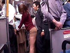 Japanese bitch sucks dick in a public bus