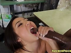Japanese tiny babe sucking on two BBCs in trio