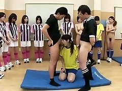 Sexy teen is on her knees sucking 2 cocks for the team